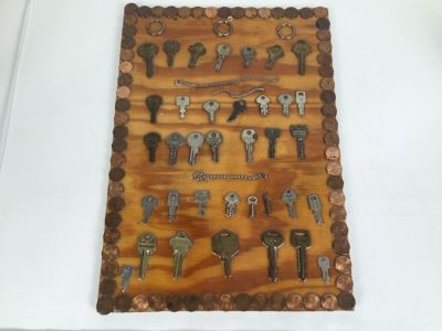 Folk Art Piece Showing Various Keys Surrounded By Pennies