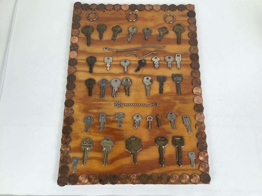 Folk Art Piece Showing Various Keys Surrounded By Pennies [Photo 1]