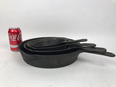 (4) Cast Iron Skillets - Largest Skillet Is A 'Wagner' Sidney 0 10