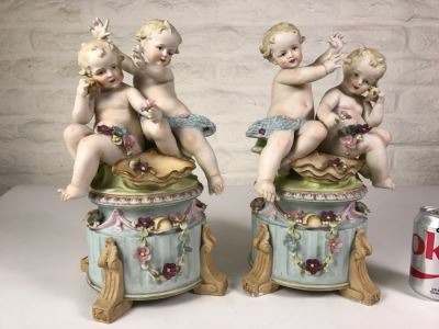 Pair Of Large Hand Painted Figures Of Young Boys On Pedestal Signed Underneath