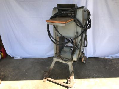 Industrial Woodworking Planer On Casters Used To Build Custom Ship Working