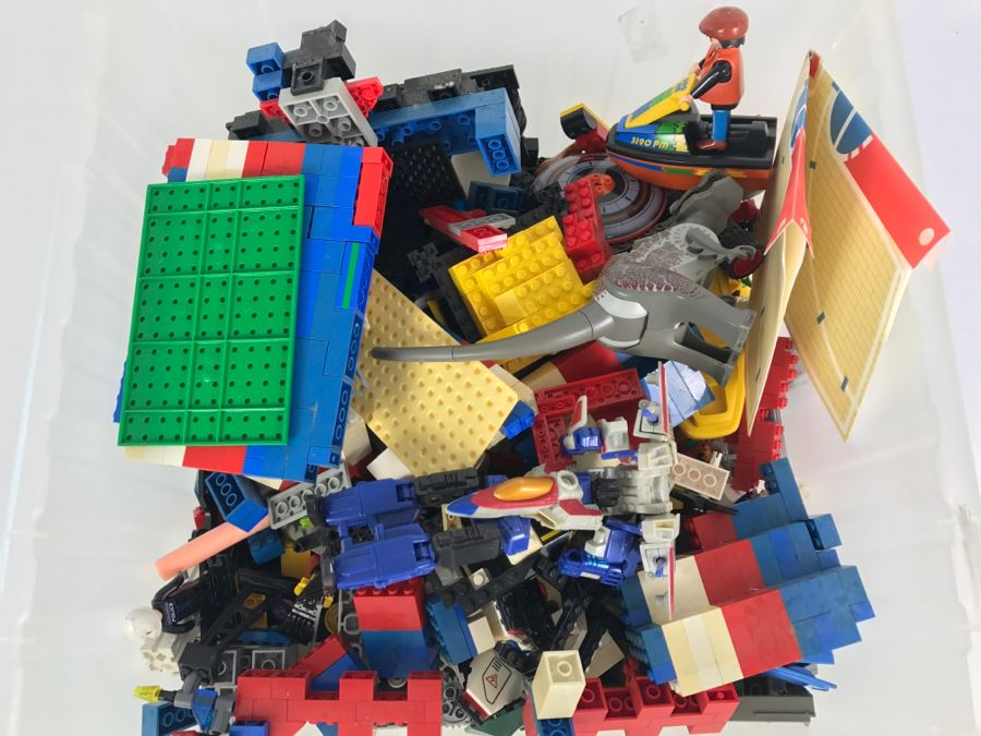 Plastic Bin Filled With Assorted LEGO Toys, Transformer And Other Toys