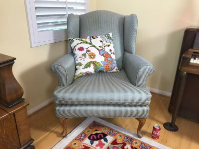 Nice Wingback Upholstered Chair With Throw Pillow