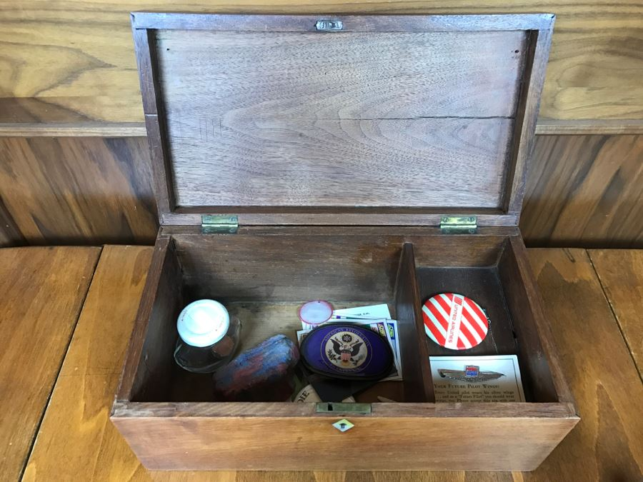 vintage wooden box with various keepsake items including united
