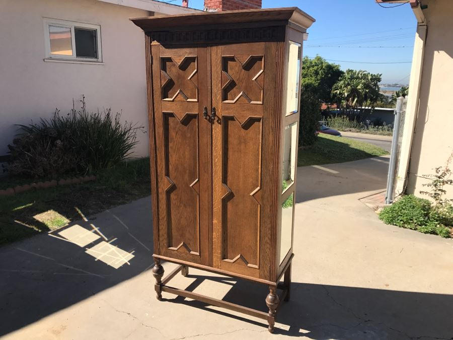 JUST ADDED - Antique Mission Style Oak Armoire With Clean Wooden Carvings And (6) Beveled Glass Side Mirrors And Bar For Hanging Clothes- See Photos