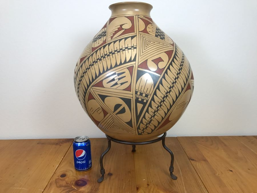 Large Signed Mata Ortiz Pottery By Miguel Bugarini En Santa Fe From The Frank Howell Gallery With Wrought Iron Stand 15'W X 18'H Estimate $250 [Photo 1]
