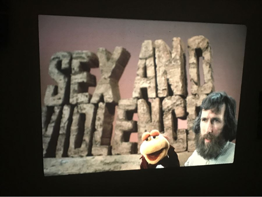 Original Early Slide From Jim Henson's Muppet Show Pilot Titled 'The Muppet Show: Sex And Violence' 1975 By Photographer Charles Rowan Featuring Jim Henson Holding Early Kermit The Frog