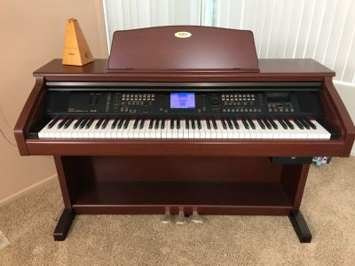 KAWAI Digital Concert Performer Piano Model CP137M With Bench, Seth Thomas Metronome And Sheet Music Books Estimate $2,000