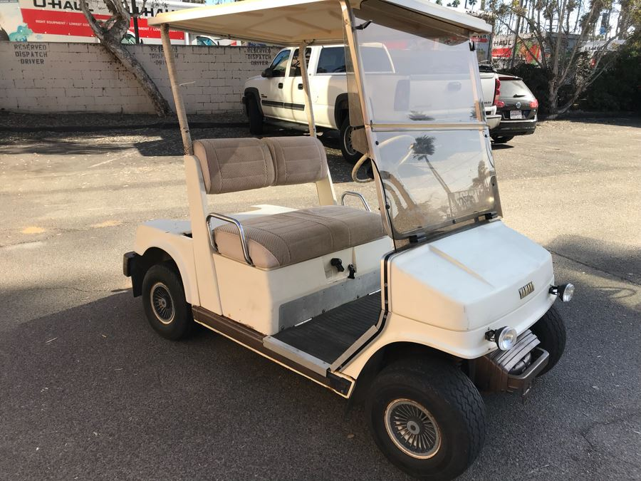 Working YAMAHA Electric Golf Cart (Client Recently Paid $750 To Service Cart 5 Months Ago) With Portable Battery Charger (Note That One Tire Is Flat And May Need Replacing) [Photo 1]