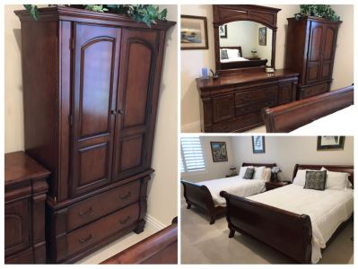 Guest Wooden Bedroom Set Includes: (2) Queen Size Sleigh Beds With Mattresses, Boxsprings And Bedding, Dresser With Mirror, (2) Nightstands And Armoire (Armoire Has Chip)  - See Photos