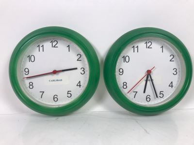 Pair Of Green Quartz Clocks Showing Carlbad And Dublin Time