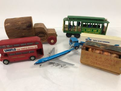 San Francisco Cable Car, California Redwood Logger Wooden Truck, KLM Boeing 747, KLM Truck, England Budgie Toy Double-Decker Bus, Oranges