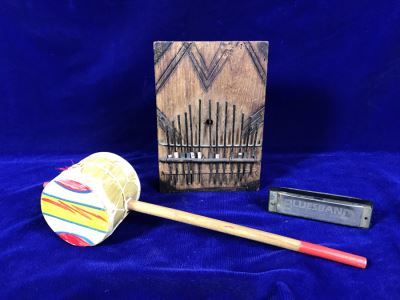 R: Bluesband Hohner Harmonica, C: Vintage African Mbira Musical Instrument, L: Rattle