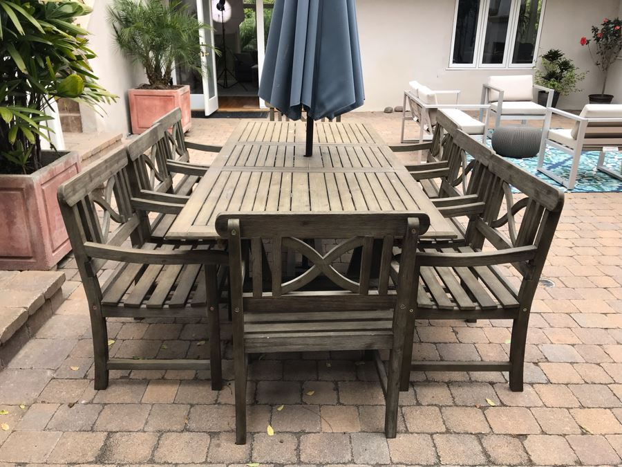 Large Outdoor Wooden Dining Table With (8) Wooden Outdoor Armchairs And Umbrella Manufacturer Unknown 90.5L X 39W X 29H [Photo 1]