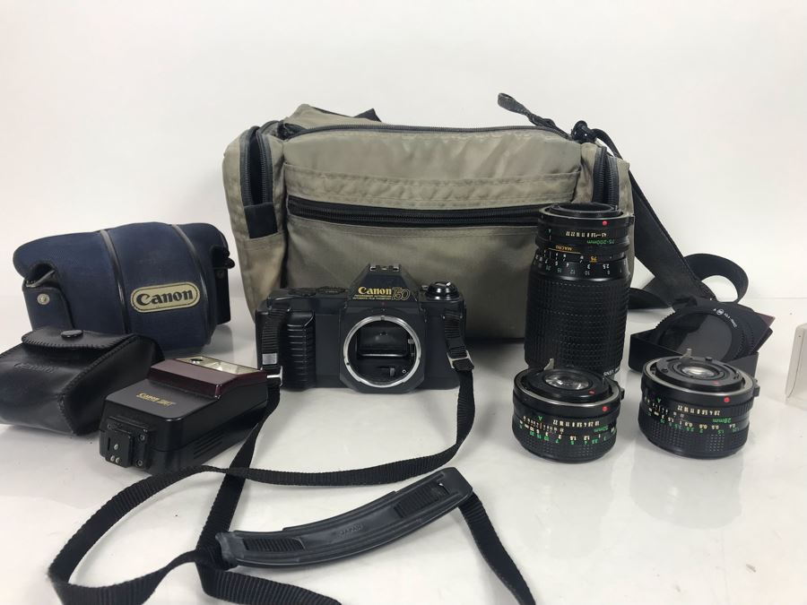 JUST ADDED - Canon Photography Lot Featuring Canon T50 Camera, Flash, Three Canon Camera Lenses, Filters And Camera Bag [Photo 1]