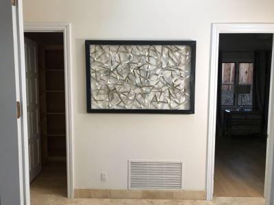 Three-Dimensional Twisted Metal Artwork 60' X 40'