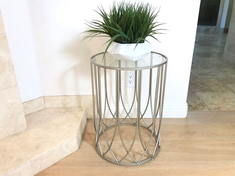 Contemporary Round Metal Glass Top Table With Artificial Plant 17'R X 23'H [Photo 1]