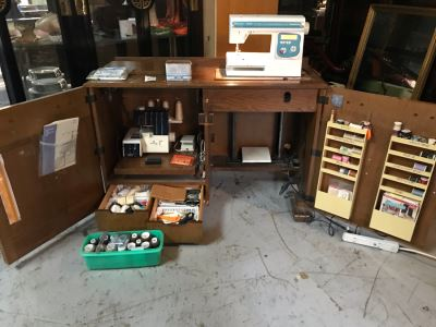 Mega Sewing Lot: Includes Husqvarna Viking Scandinavia 200 Sewing Machine Made In Sweden, Husqvarna Huskylock 560 Sewing Machine, Tons Of Sewing Supplies And Wooden Sewing Cabinet With Motorized Lift 46W X 20D X 32H - See Photos