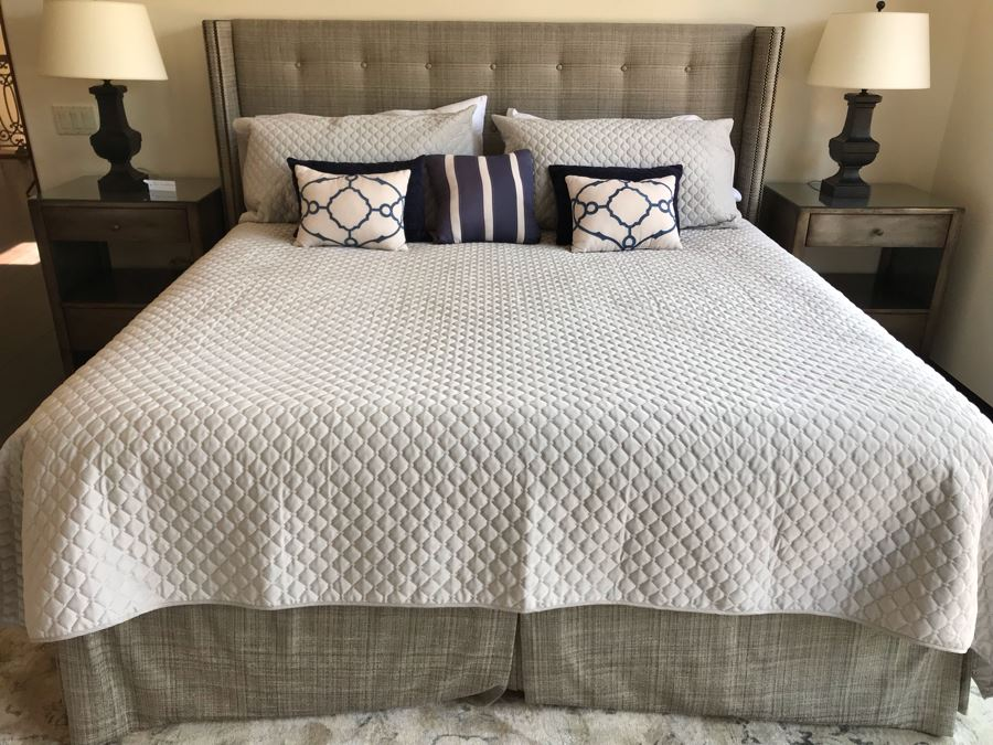 King Size Bed With Upholstered Tufted Headboard With Brass Nailhead Trim, Throw Pillows And Bedding Including Bed Skirt Includes Like New Sealy Mattress And Boxspring (Was Guest Bed For Grown Twin Kids - Rarely Used) [Photo 1]
