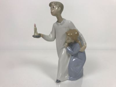 JUST ADDED - Lladro Porcelain Figurine Of Boy Holding Candle With Girl 9.5W X 8H (MOE)