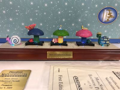 HAND SIGNED By Robert Olszewski Disneyland Main Street, USA Collection: First Edition Main Street Electrical Parade (Set #2) By Robert Olszewski Disney Theme Park Attraction Miniature Model With Box And COA 10.5W X 2.75D DL0602 (Estimate $300-$700)